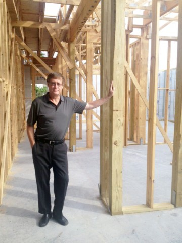 Dale posing in a home being built by Skyway Builders