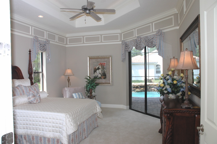 Master bedroom customized with sliding glass door entry to covered lanai