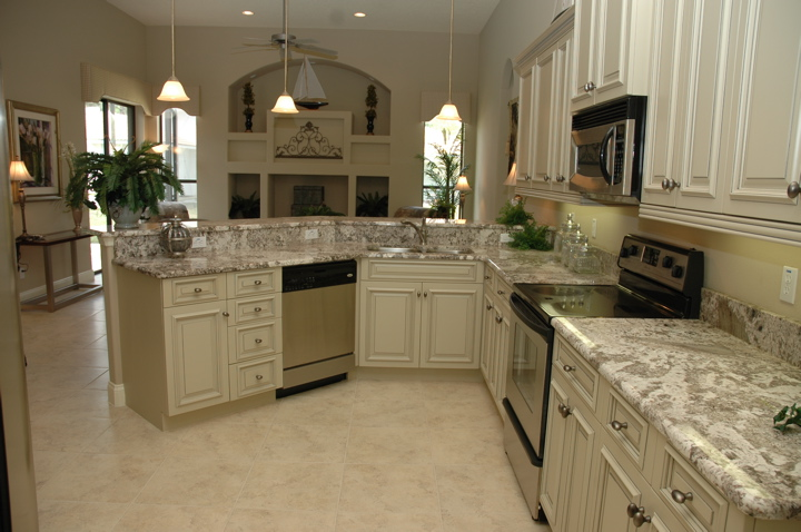 Modern custom kitceh with light colored cabinets and countertop