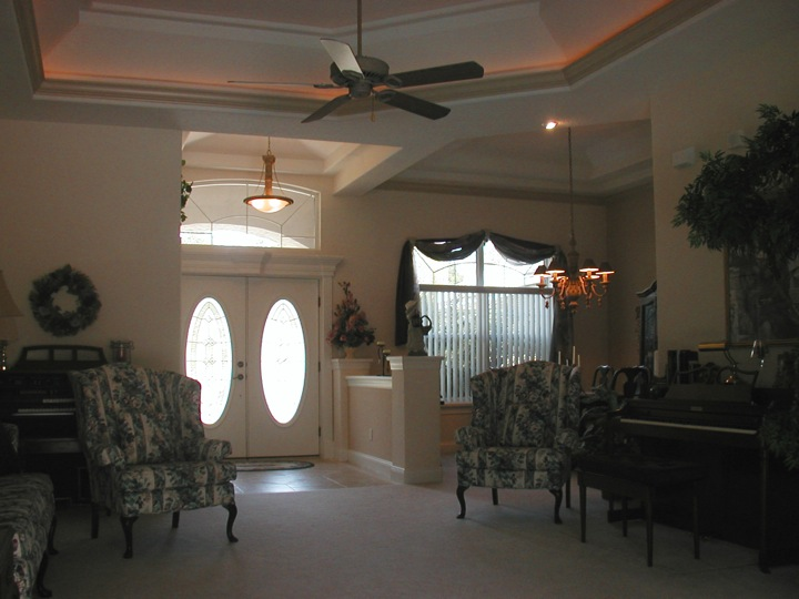 Home entryway with high ceiling and ceiling fan
