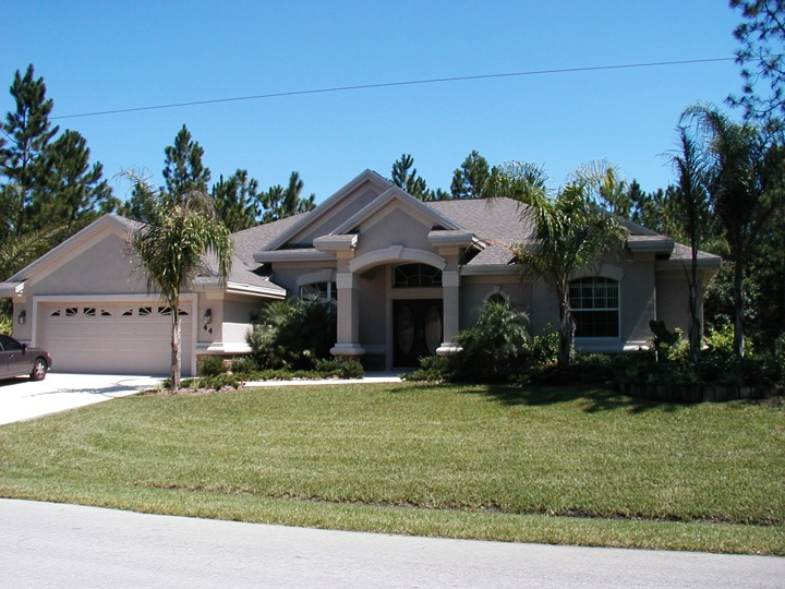 Front of skyway builder custom home with decorative columns and white trim