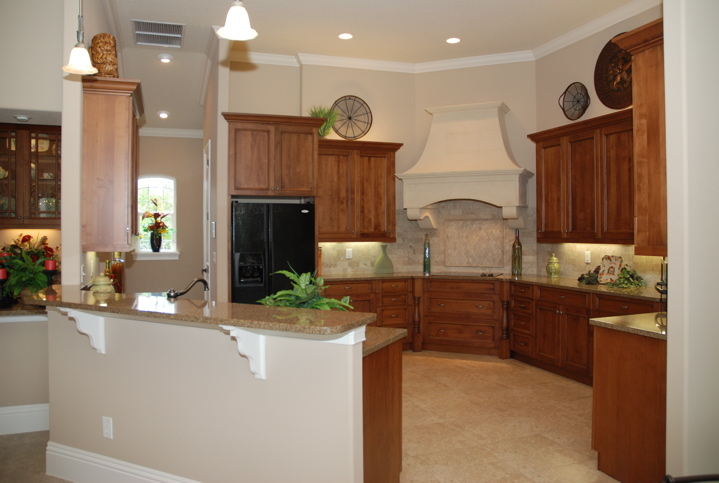 Kitchen with drop pendant lighting and recessed lighting