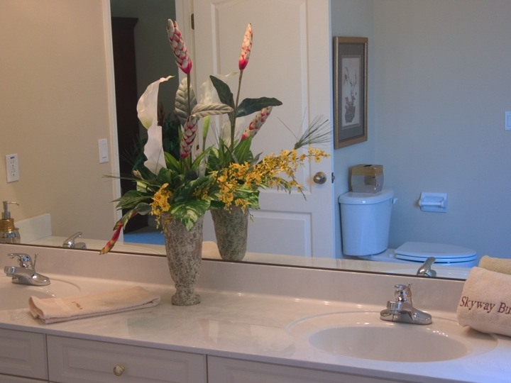 Large mirror and floral arrangement in bathroom