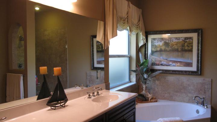 Corner tub and double vanity sink in custom master bathroom