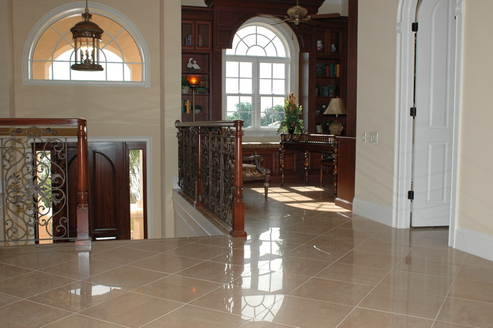 Marble tile with stairs leading down to front entrance of home