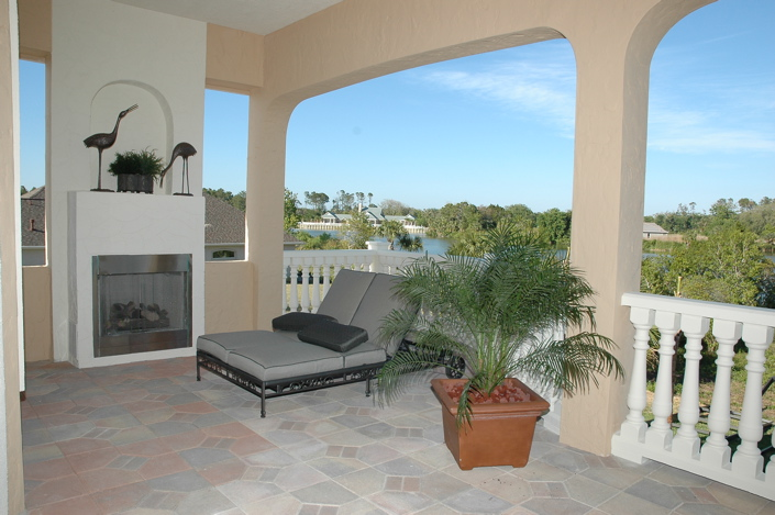 outdoor lanai with fireplace and comfortable custom furniture