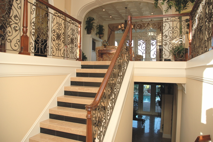 Stairs with swirly custom metal railing