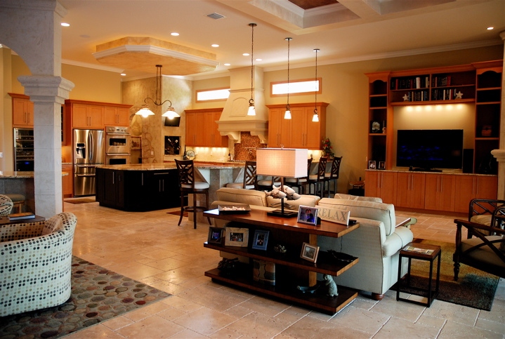 Living room and kitchen with custom tile and lighting