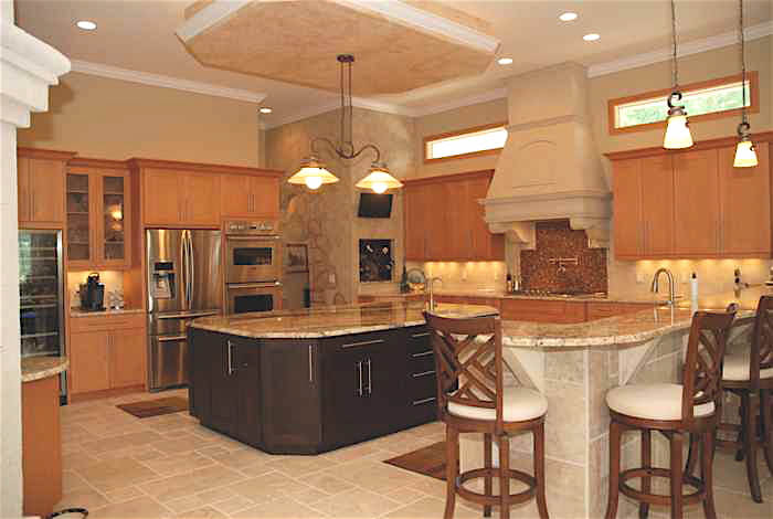 Open kitchen with drop and recessed lighting