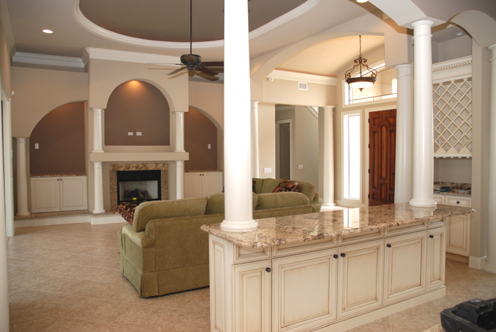 Bar with marble countertop dividing the kitchen and living area