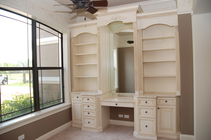 Built in shelving and drawers with antique finish