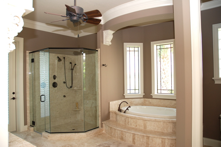 Step up tub and glass enclosed shower in master bathroom