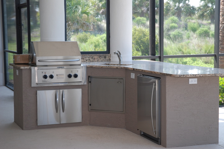 Outdoor kitchen with marble counter top and stainless steel appliances