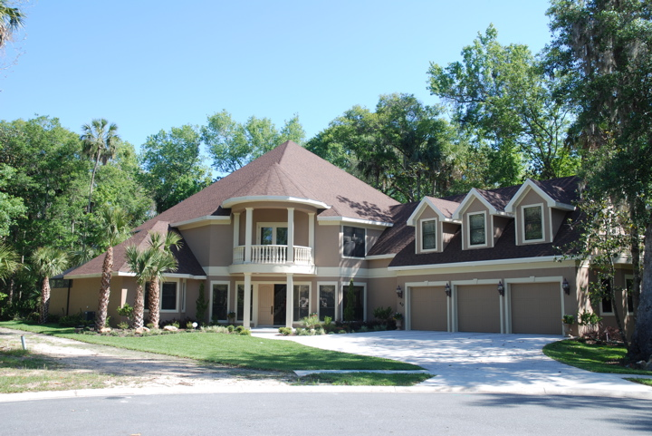 Custom home with three car garage on a corner lot