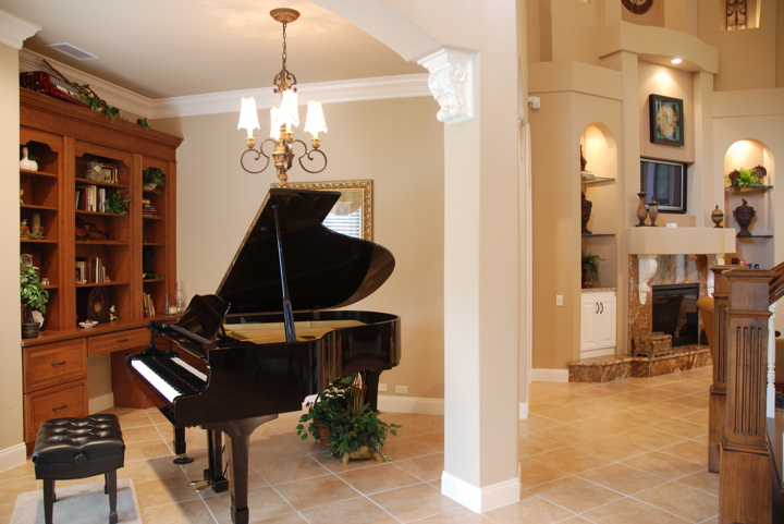 Grand piano in office area of open floor plan