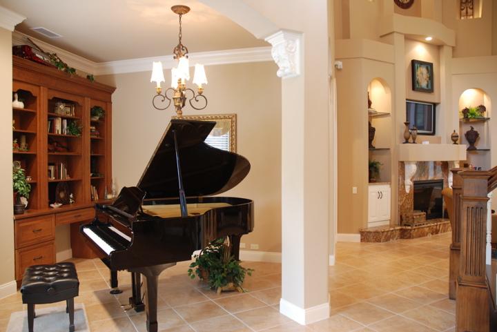 Grand piano in office area of open floor plan