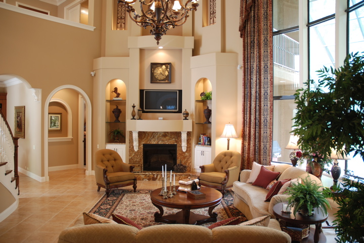 Living room with fireplace and high ceilings