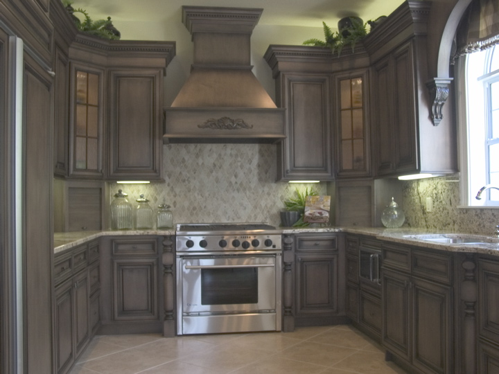 Kitchen with dark wood cabinets and custom marble backsplash