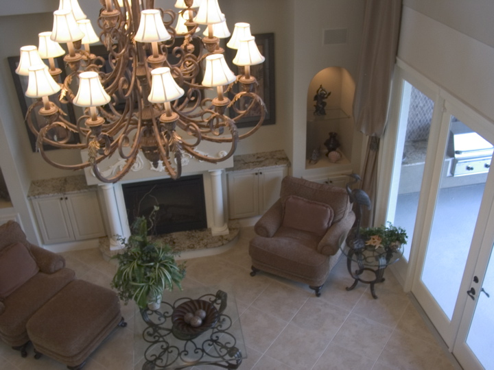 Image of chandelier in living area with custom tile flooring