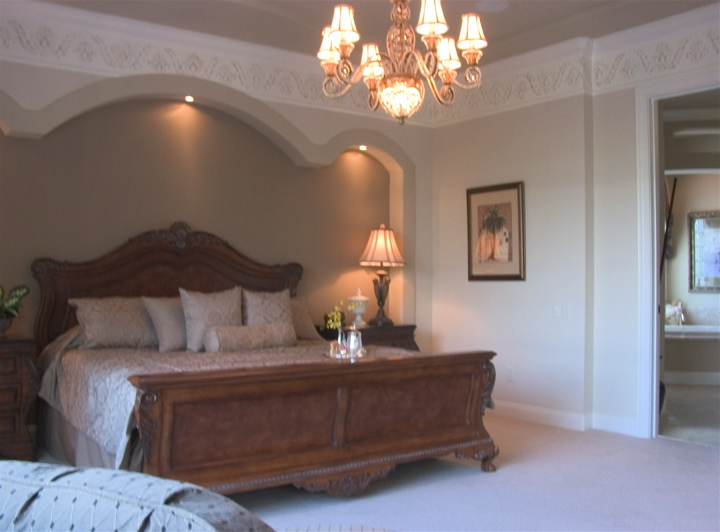 Chandelier in the center of a custom master bedroom