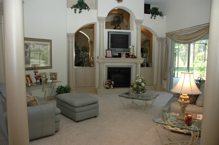 Living room with custom built in entertainment center and white walls