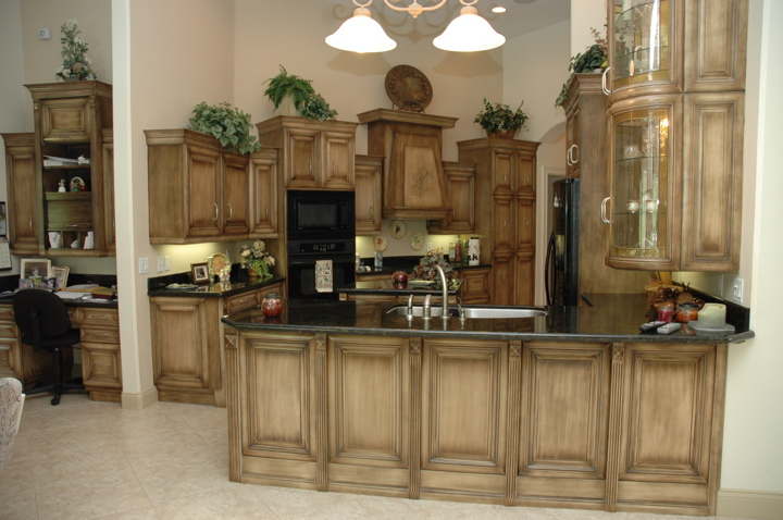 Custom kitchen with custom cabinets and black appliances