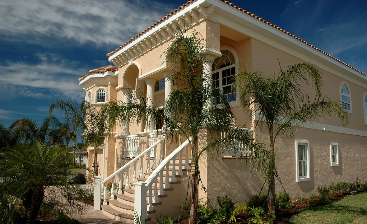 Two story home with grand staircase leading to front entrance