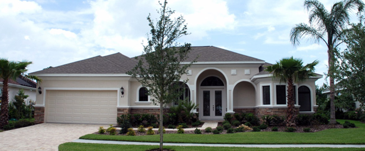 Skyway Builders custom home model with two car garage and arched details