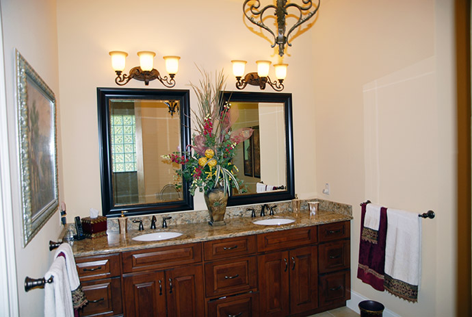 Master bathroom with dual sink and mirror vanity