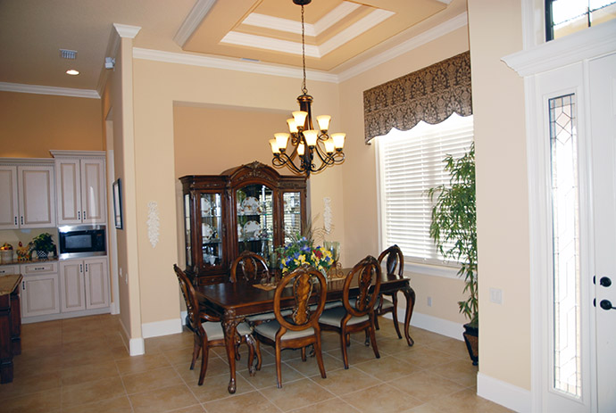 Dining area with dining table and curio cabinet
