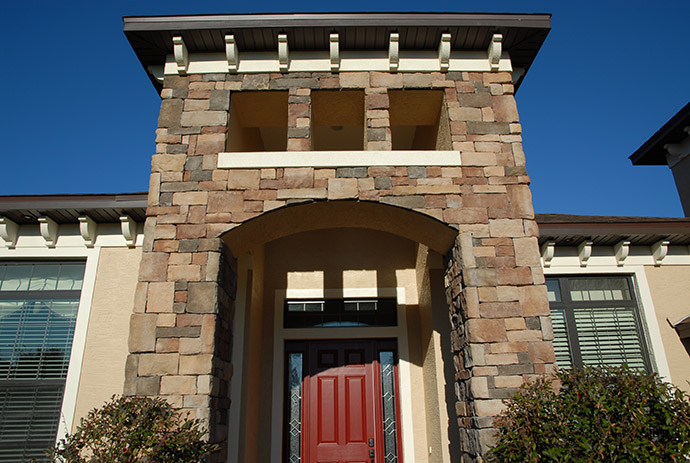 Exterior of front entry way with red custom door