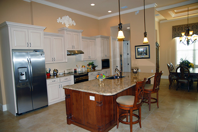 Kitchen island with sink and two barstools