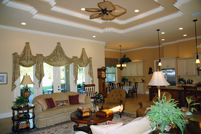 High ceiling in living room with detailed crown molding