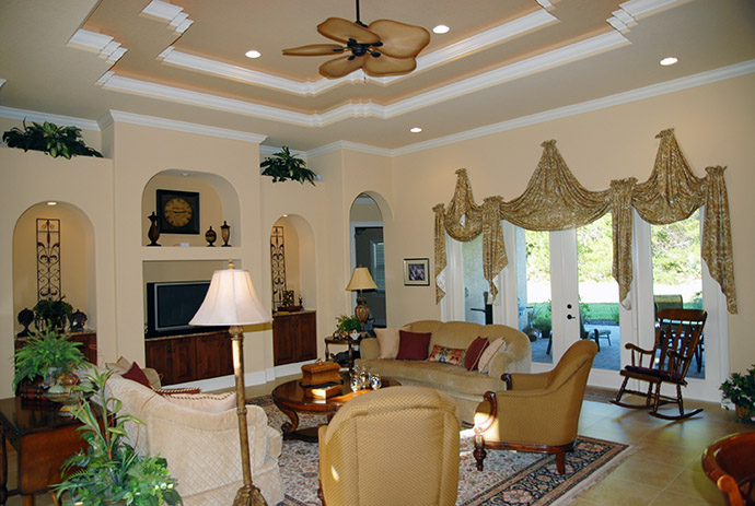 Living room with glass french doors and tall windows