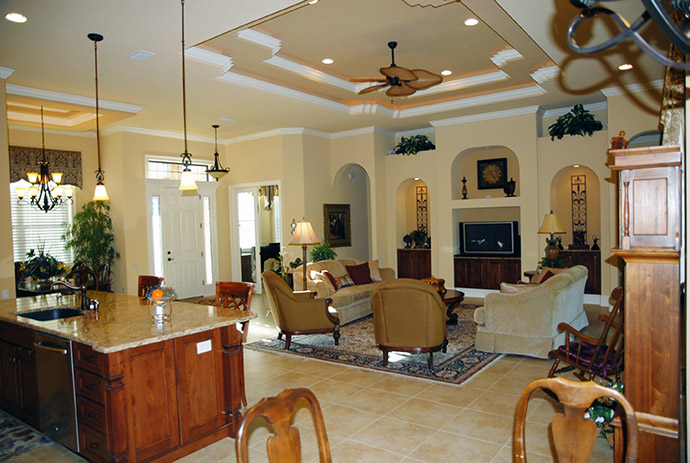 Living room with Persian rug and arched wall cut outs