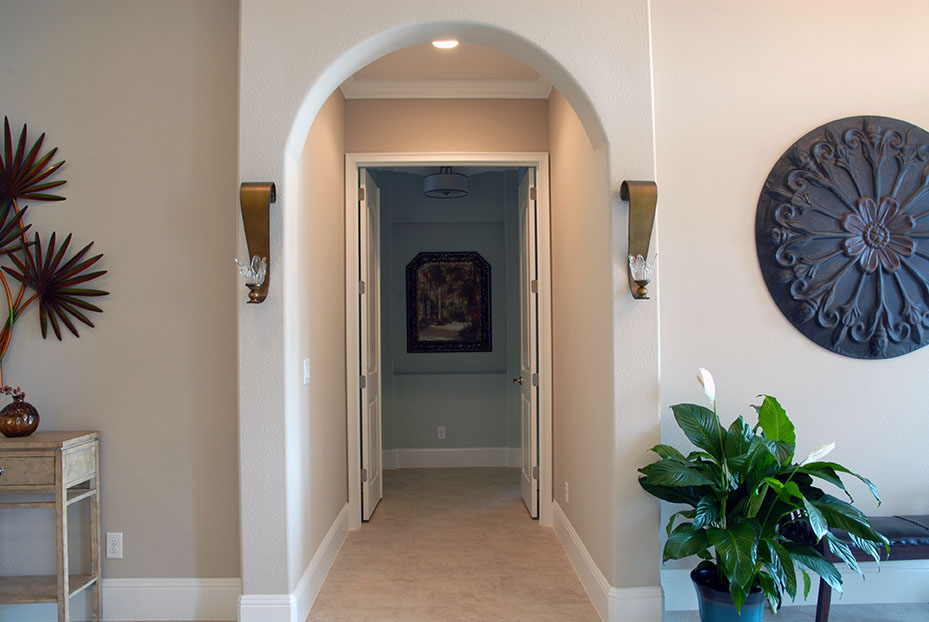Arched hallway leading to bedroom