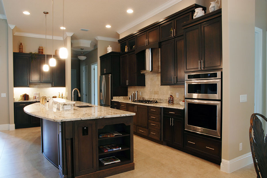 Dark cabinets and stainless steel appliances in custom kitchen from Skyway Builders
