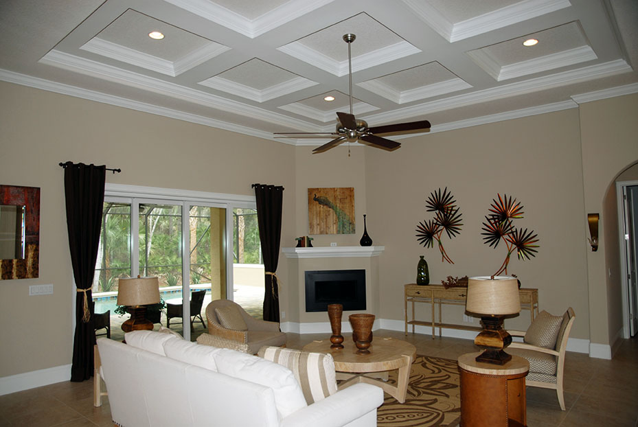 Contemporary living room with sliding doors leading to the covered lanai