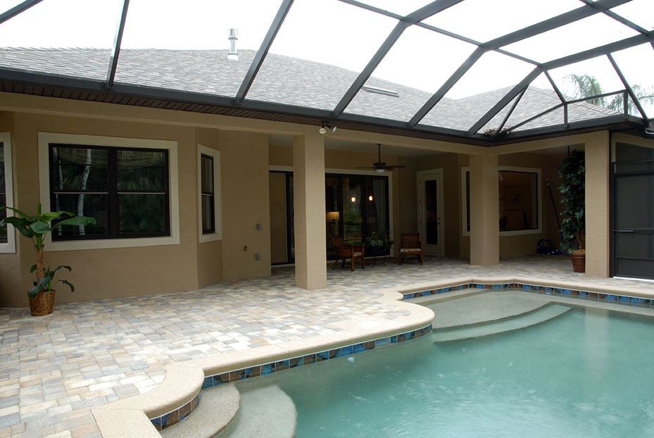In ground pool inside covered lanai with two entry points