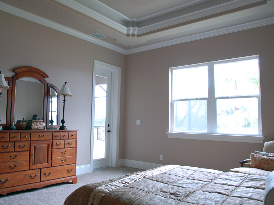 Bedroom with dresser and mirror