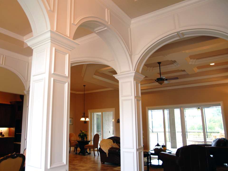 Detailed interior white columns with arches connecting them