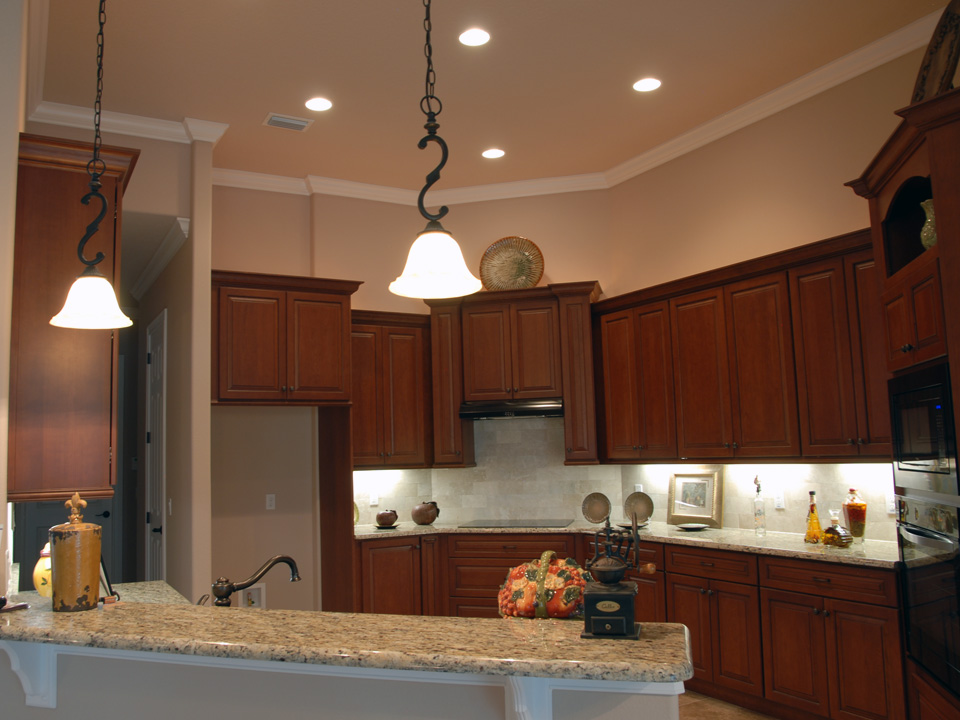Corner kitchen with custom cabinets to fit the space perfectly