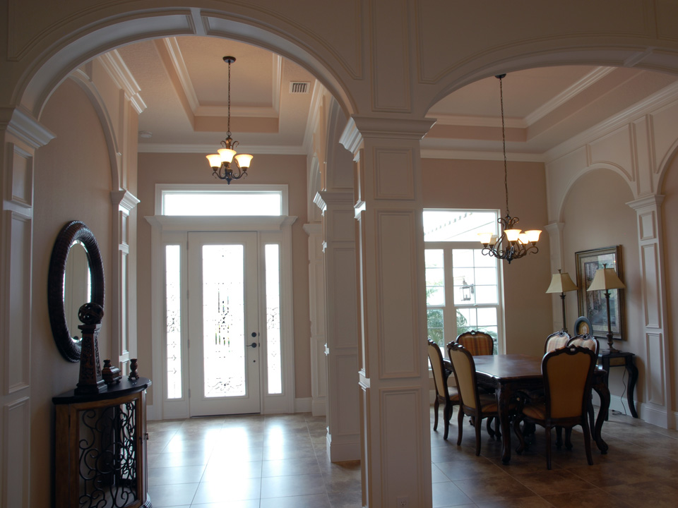 Interior view of glass front door and dining room
