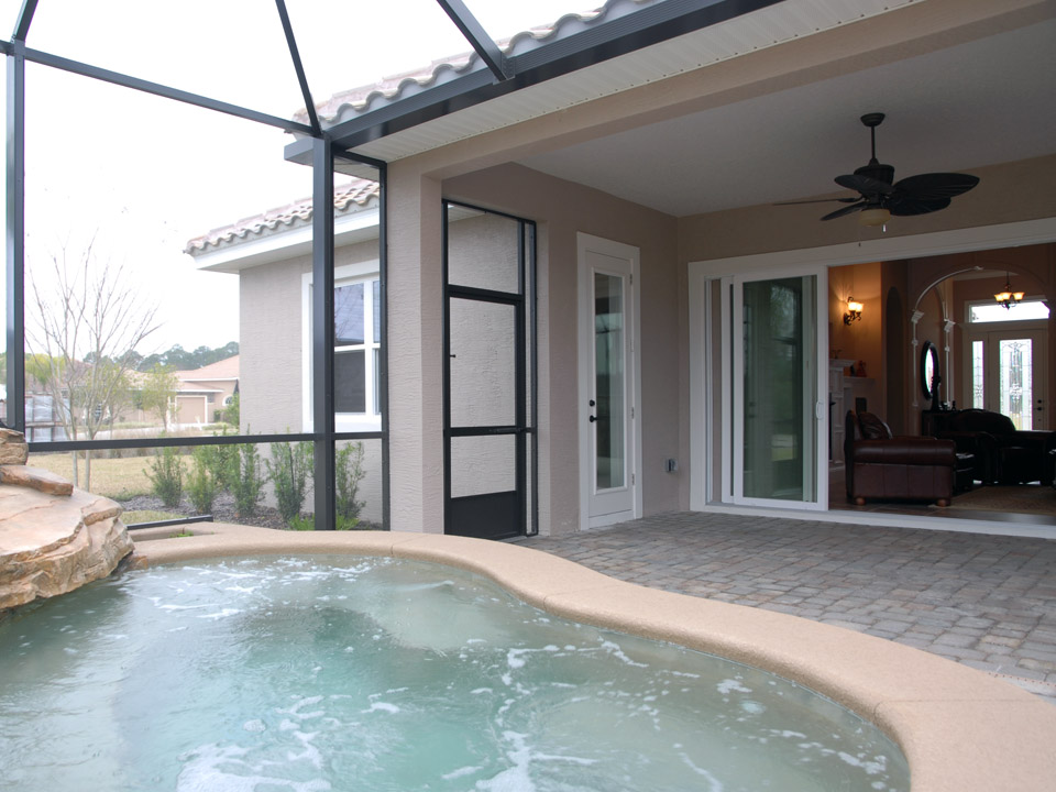 Bubbling hot tub in glassed in lanai in Florida
