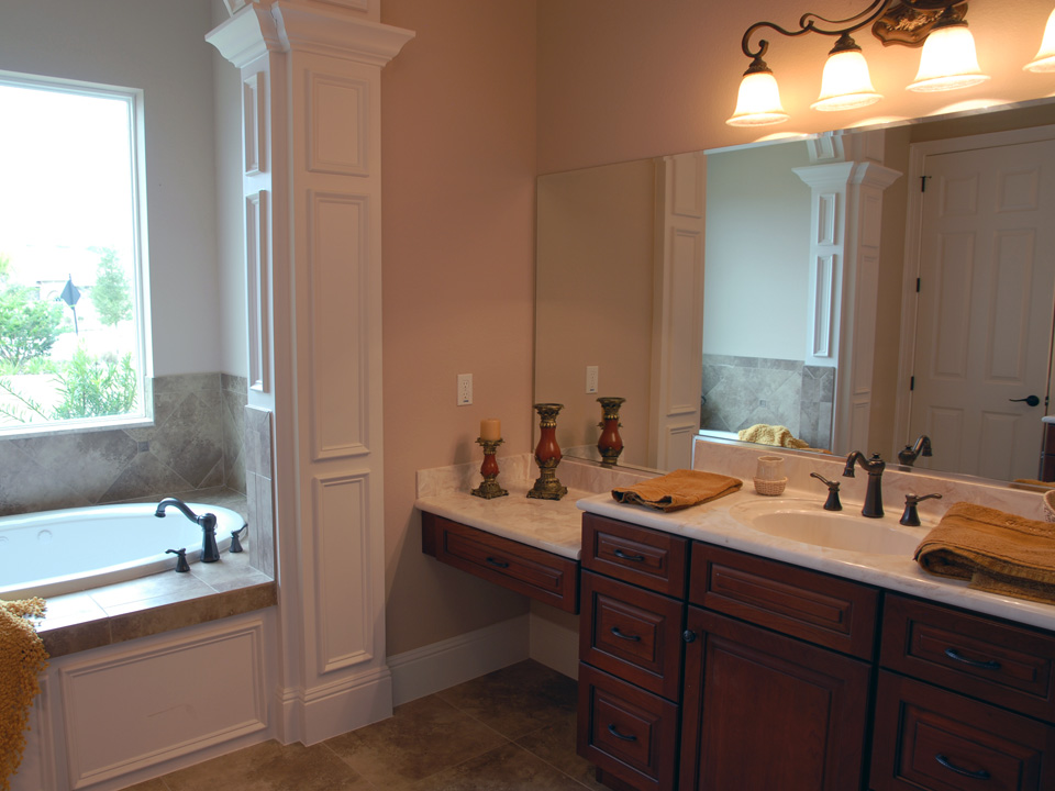 Master bathroom with custom white detailed columns