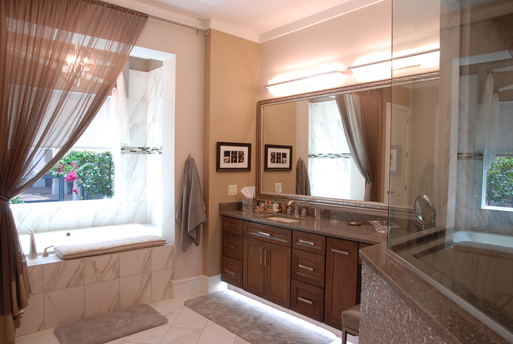 Master bathroom with single sink vanity and large glassed in shower and soaking tub