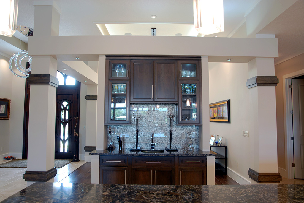 bar area with dark wood and dark marble counter tops
