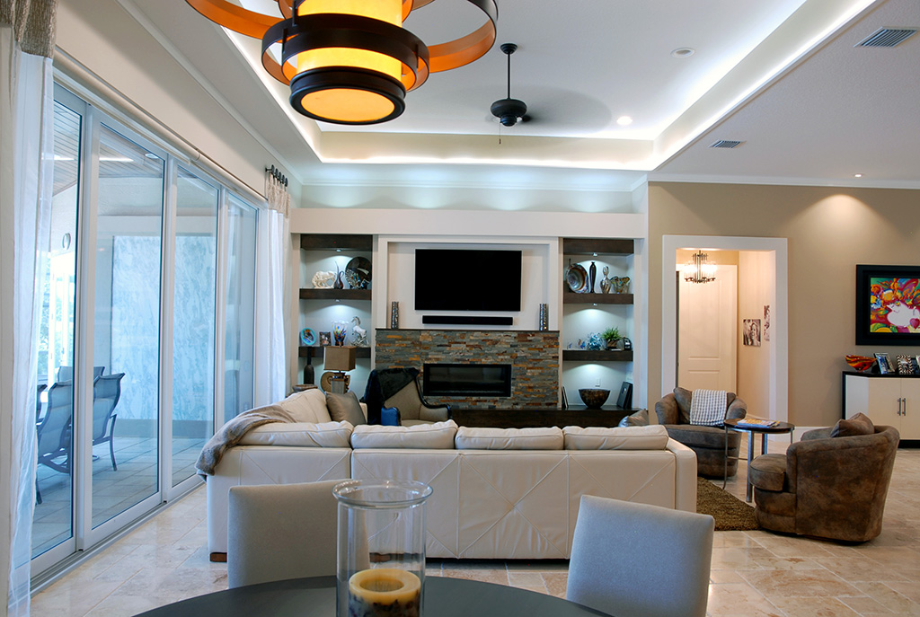 Living area with built in shelving and custom stone fireplace