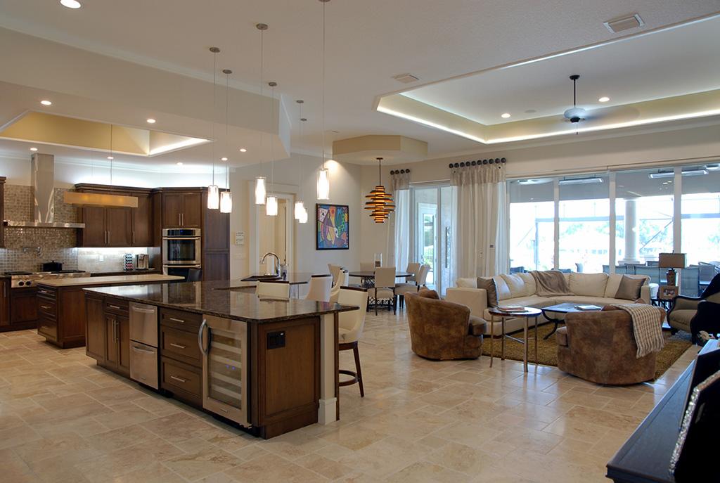 Open floor plan layout displaying living room, breakfast nook and kitchen