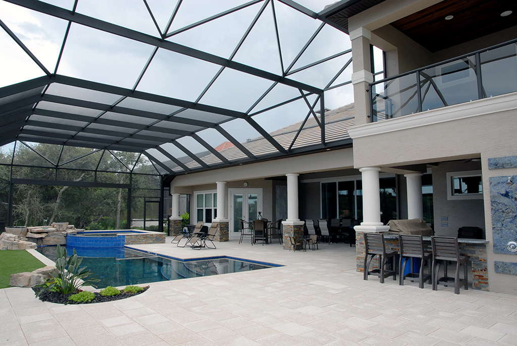 Balcony overlooking in ground pool and bar area
